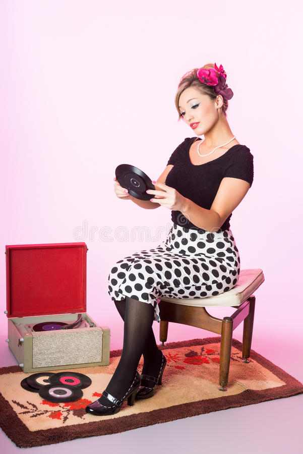 Vintage pinup style of cute blond with vinyl records stock image