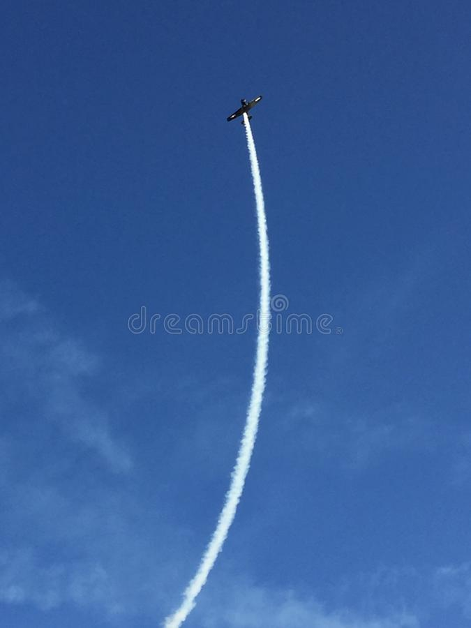 Vintage Plane with vapor trail stock photography
