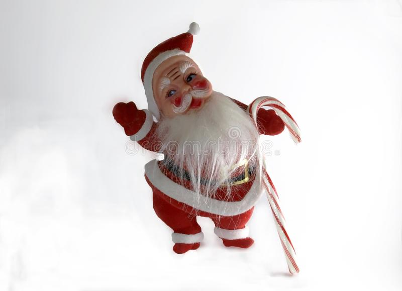 Vintage Plastic Santa Claus Holding a Candy Cane royalty free stock photos