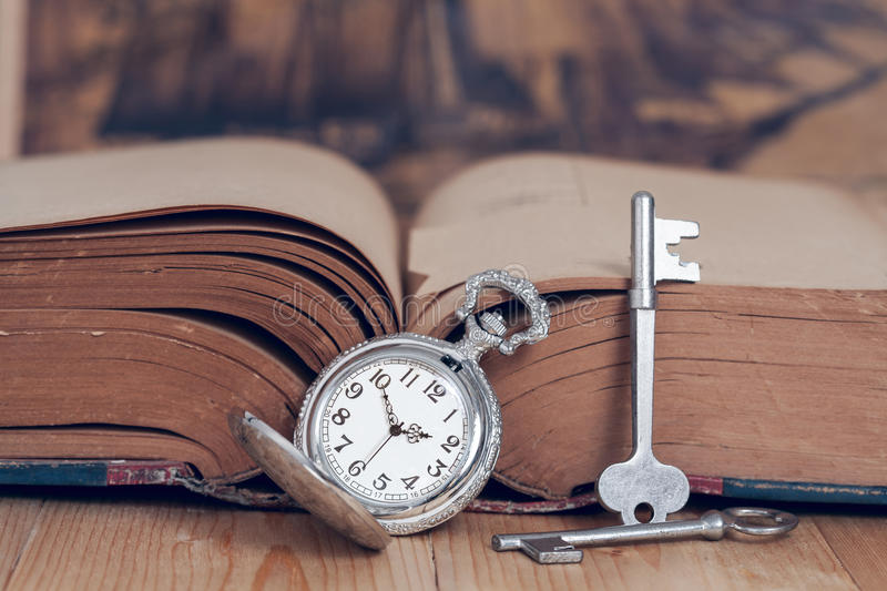 Vintage pocket watch on books. royalty free stock photography