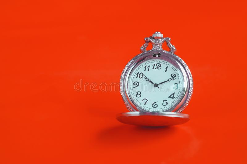 Vintage pocket watch on color royalty free stock images