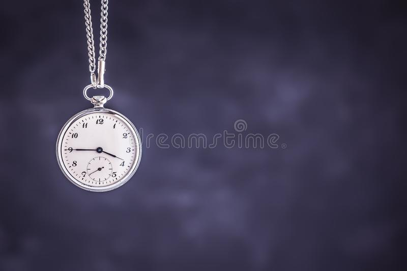 Vintage Pocket Watch on Dark Background. Deadline and Time Management Concept. royalty free stock photo