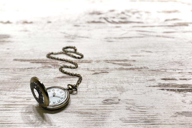 Vintage Pocket Watch on Old Aged Wood Background royalty free stock images