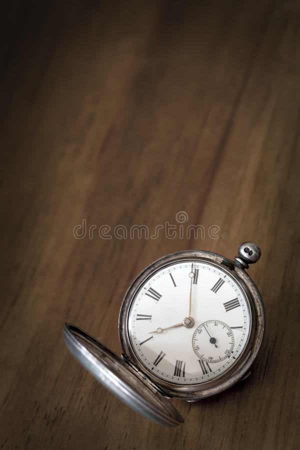 Vintage Pocket Watch Over Grunge Timber Royalty Free Stock Photo