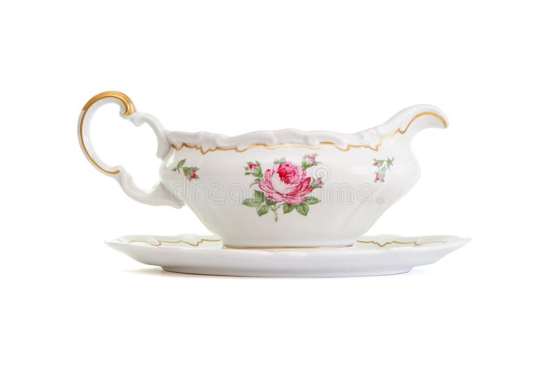 Vintage porcelain sauce-boat isolated stock photo