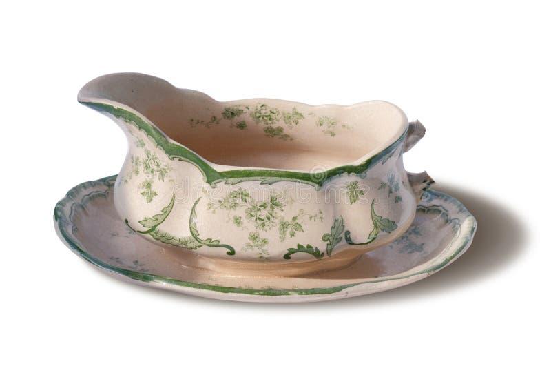 Vintage porcelain sauce-boat. Isolated on white background royalty free stock photo