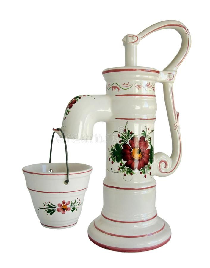 Vintage standpipe and bucket. Vintage porcelain street standpipe and bucket decorated with flowers isolated on white royalty free stock photography