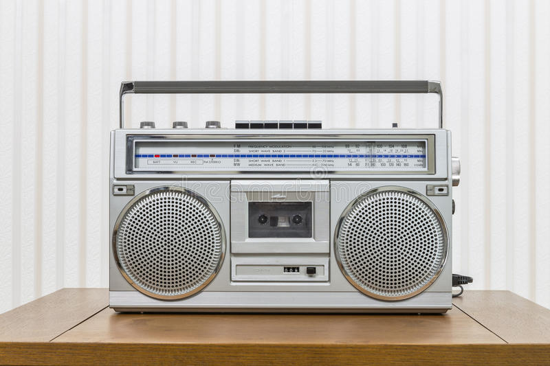 Vintage Portable Boom Box Style Radio Cassette Player. On old wood table stock photography