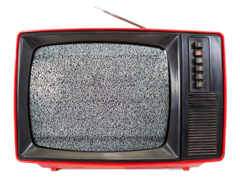 Vintage portable TV set with static noise on screen isolated on white stock photography