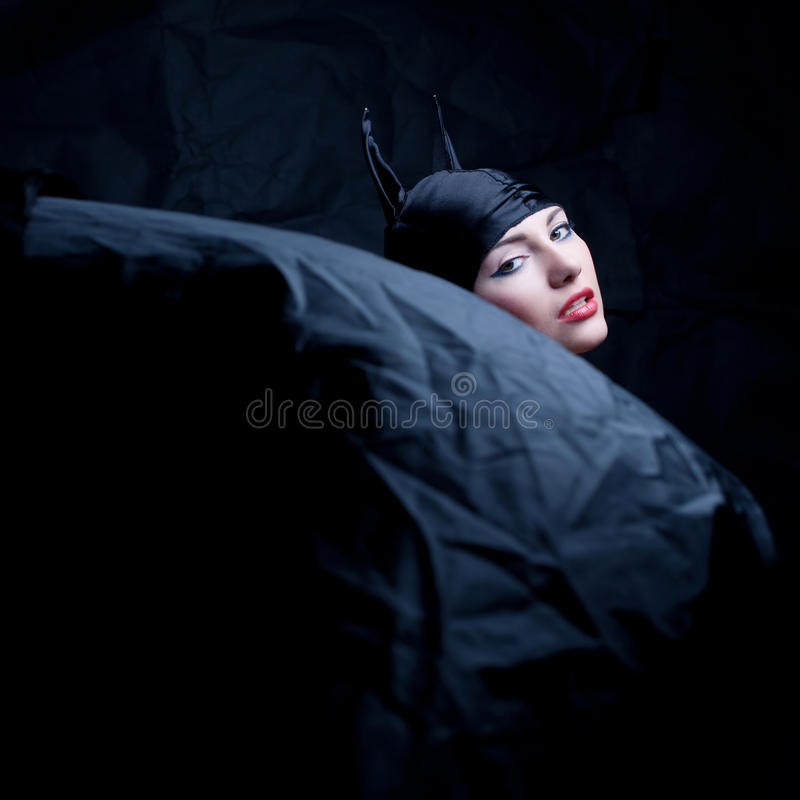 Vintage portrait of an animal girl in black. Vintage portrait of a glamourous animal girl over wrinkled black paper background. studio shot royalty free stock photography