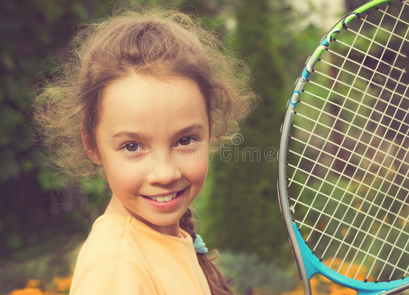 Vintage portrait of cute girl playing tennis in summer royalty free stock photography