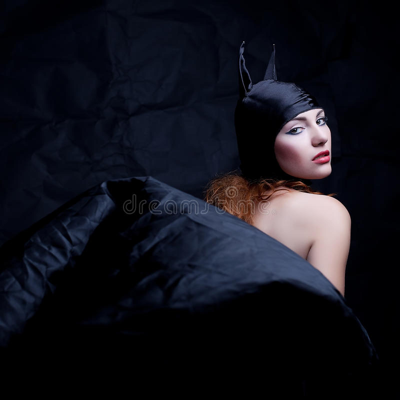 Vintage portrait of a glamourous animal red-haired girl. Over wrinkled black paper background. studio shot stock photos