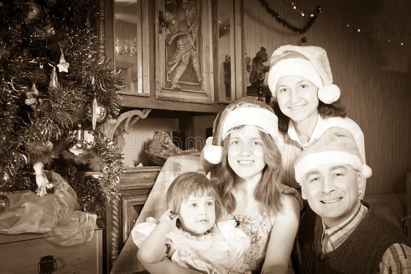 Vintage portrait of happy family. Celebrating Christmas at home stock image