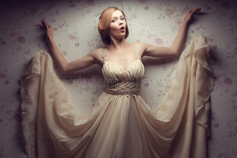 Vintage portrait of happy glamorous red-haired (ginger) girl stock photography