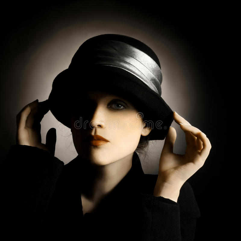 Vintage portrait lady in hat royalty free stock photography