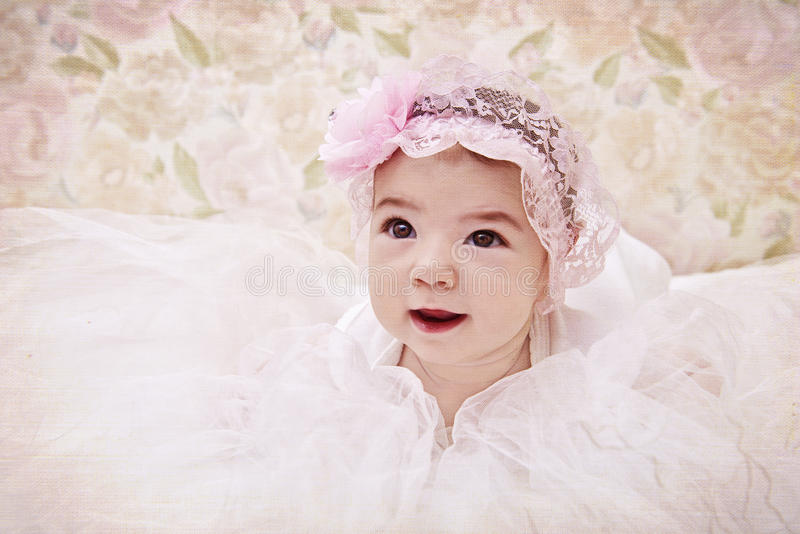 Vintage portrait of newborn baby girl in pink hat royalty free stock image