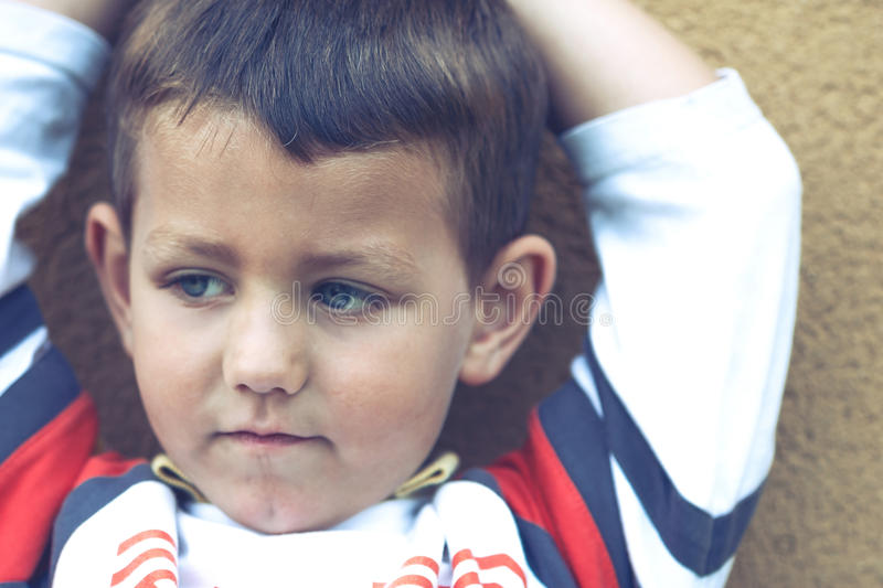 Vintage Portrait of Spanish boy with blue eyes. royalty free stock images