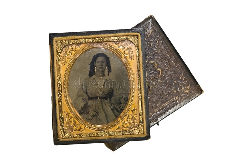 Vintage Portrait/Tin Type. A beautiful small antique, vintage photo of a women in the 1800's. Tin type in leather case with gold trim and accents stock photo
