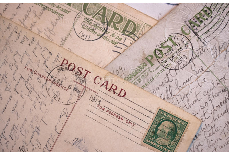 Vintage Post Cards - Background. A group of early 1900 vintage post card backs with pen and ink handwriting, postmarks and stamp royalty free stock images