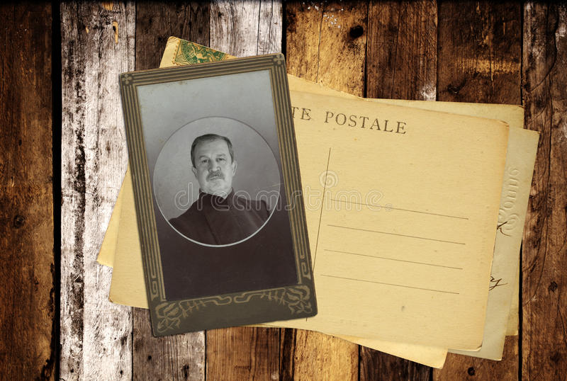 Vintage post cards and retro photo on old wooden planks. Inscription on the card - carte postale - postcard in french royalty free stock photo