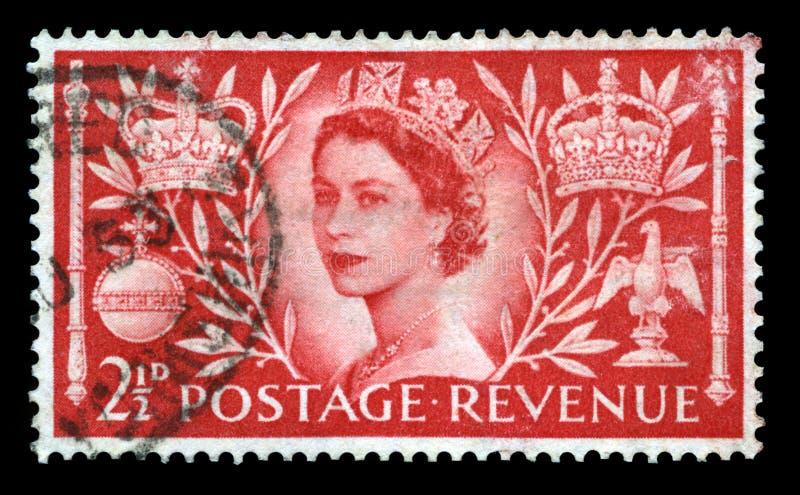 Vintage Postage Stamp Celebrating Queen`s Coronation. UNITED KINGDOM, CIRCA 1953: A vintage British postage stamp celebrating the Coronation of Queen Elizabeth stock image