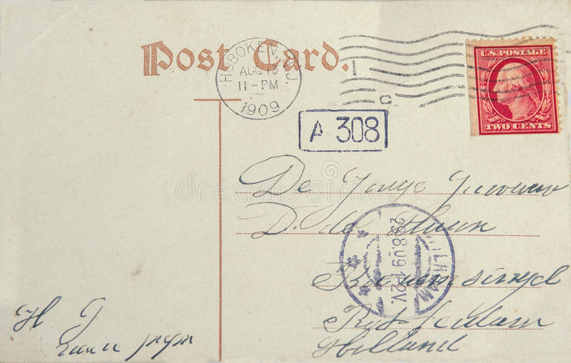 Vintage postcard with american postage stamp and address in Rotterdam, the Netherlands royalty free stock photo