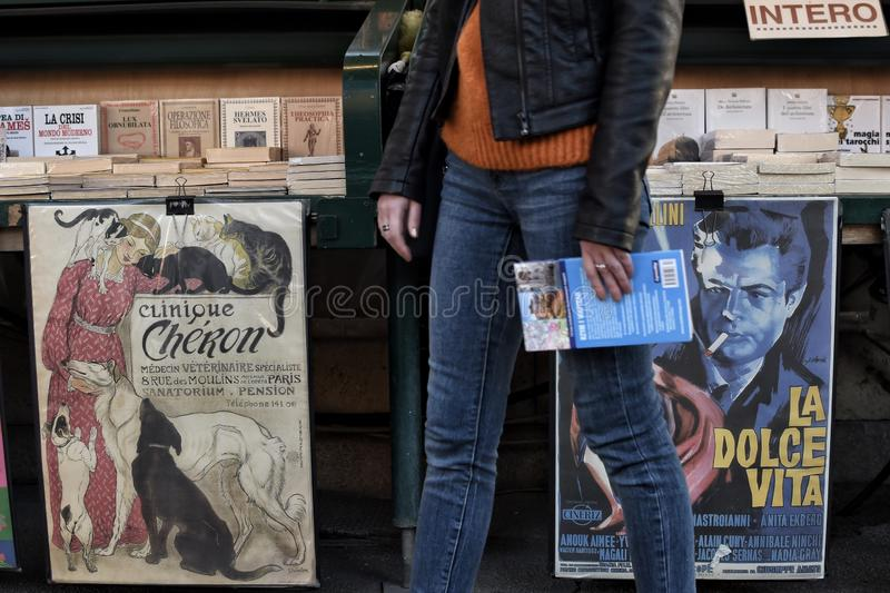 Vintage posters on a book stand stock image