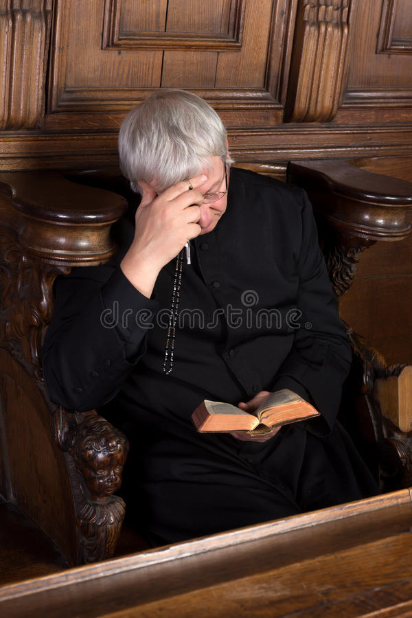 Download Priest with rosary stock image. Image of catholic, priest - 29871705