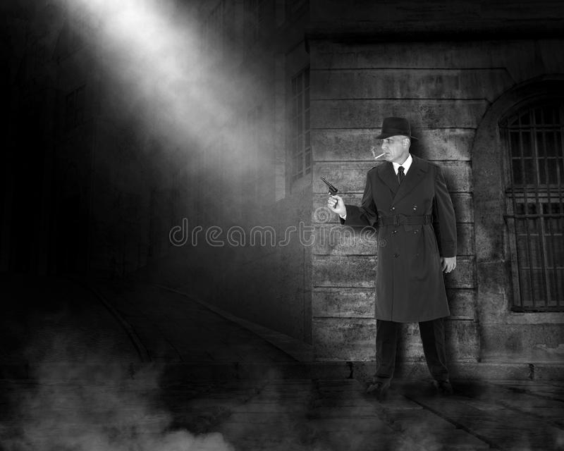 Vintage Private Eye Investigator, Detective. Vintage or retro private eye investigator or detective. The gumshoe is working at night on a dark street with his stock photography
