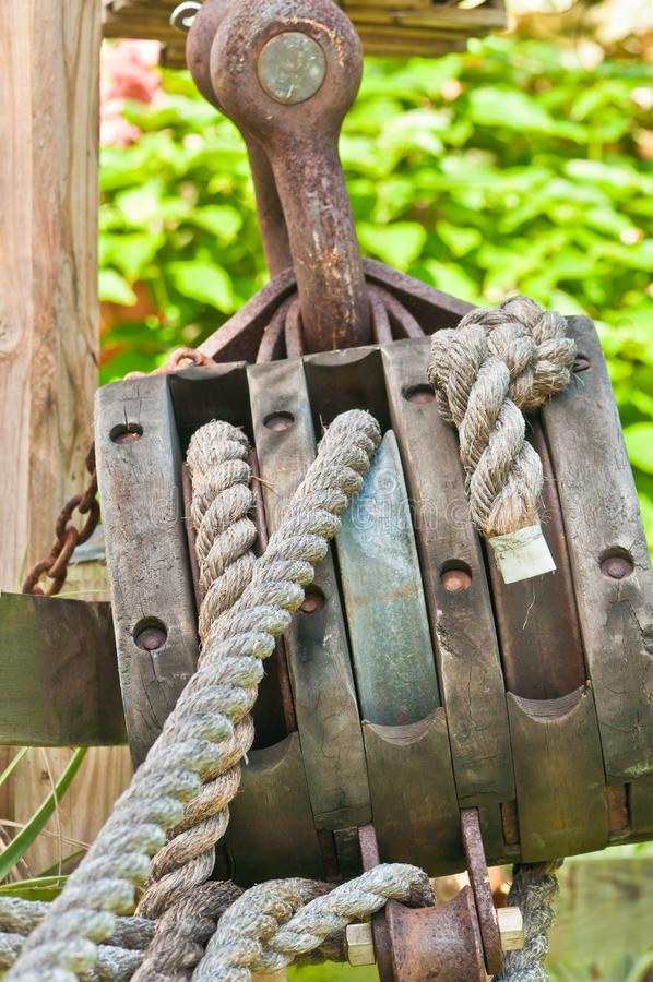 Vintage pulley and lines from an historic sailing ship stock photo