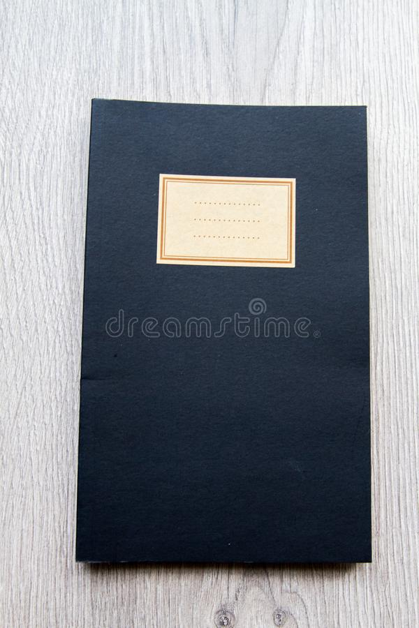 Vintage que olha o caderno preto fotografia de stock