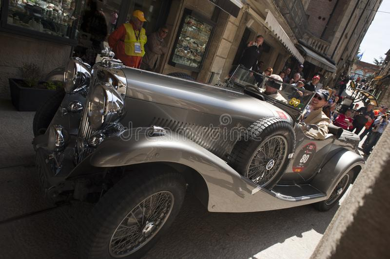 Vintage race car at the mille miglia. San marino, italy, 18 may 2012, mille miglia rally for historic cars royalty free stock photos