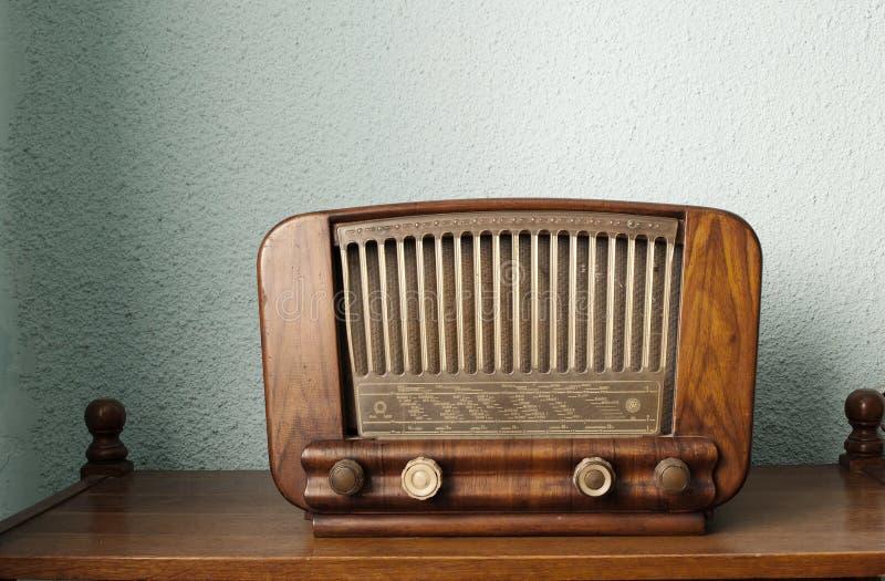 Vintage radio. Old radio on a shelf stock photography