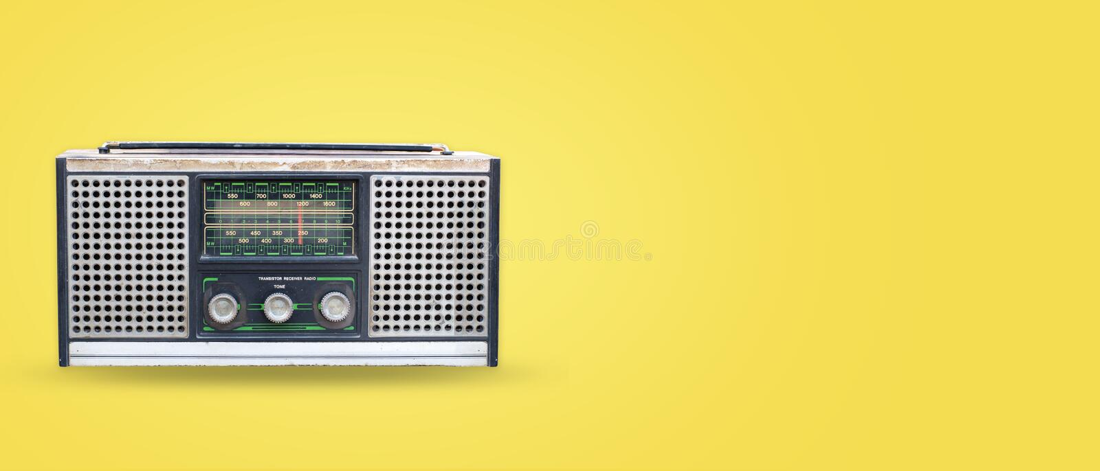 Vintage radio on pastel color background. Retro technology. flat lay, top view hero header. vintage color styles stock photos