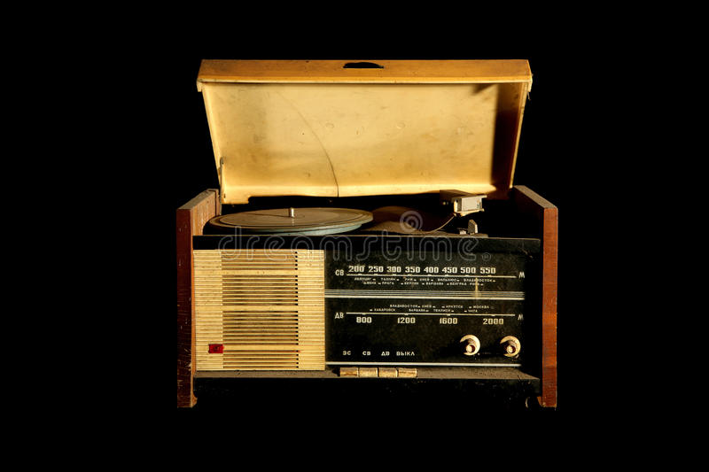 Vintage radio and vinyl player. Vintage radio and vinyl disc music player isolated on black background reporting russian propoganda royalty free stock images