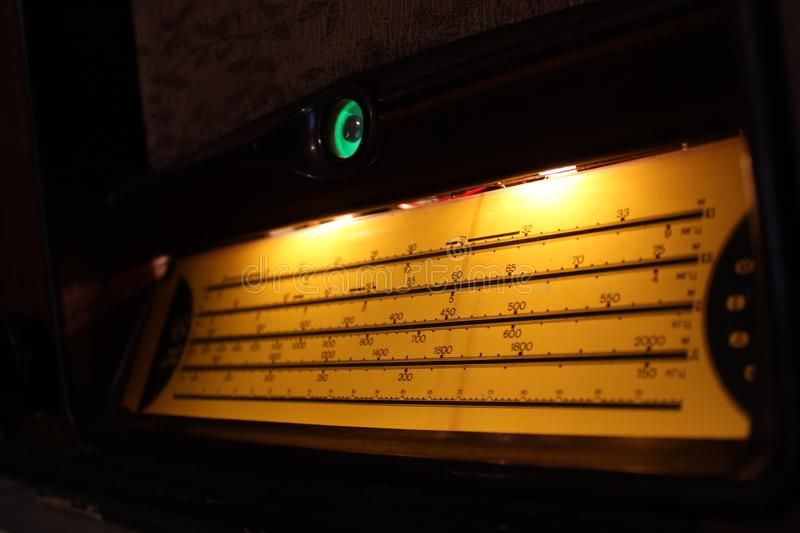 Vintage radiogram scale illuminated with yellow light royalty free stock photography