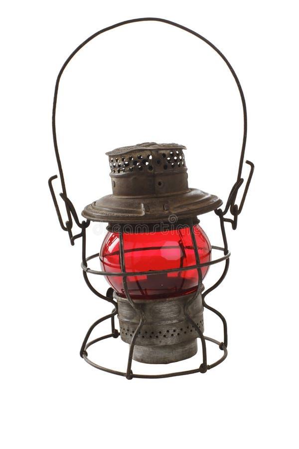 Vintage railroad lantern with red glass globe stock photos