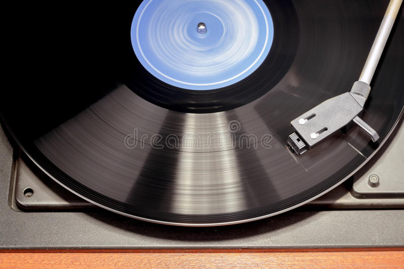 Vintage record player with spinning vinyl. Detail of vintage record player with spinning vinyl. Motion blur image stock photos