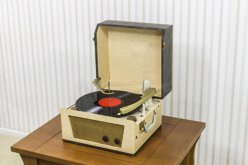 Vintage Record Player with Vinyl Album. On wood table stock images