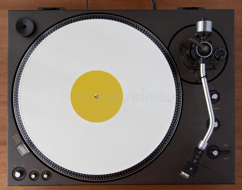 Vintage Record Turntable Player With White Vinyl Disk stock photography
