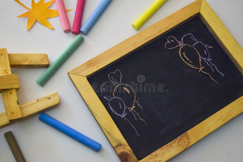Vintage rectangular chalkboard with colorful chalk isolated on white background.  stock image