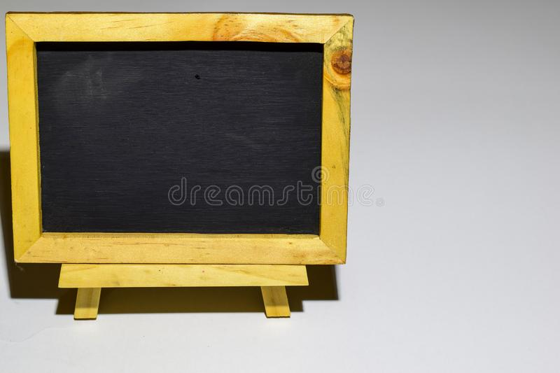 Phrase happy wednesday written on a chalkboard on it and smartphone, laptop. royalty free stock photos