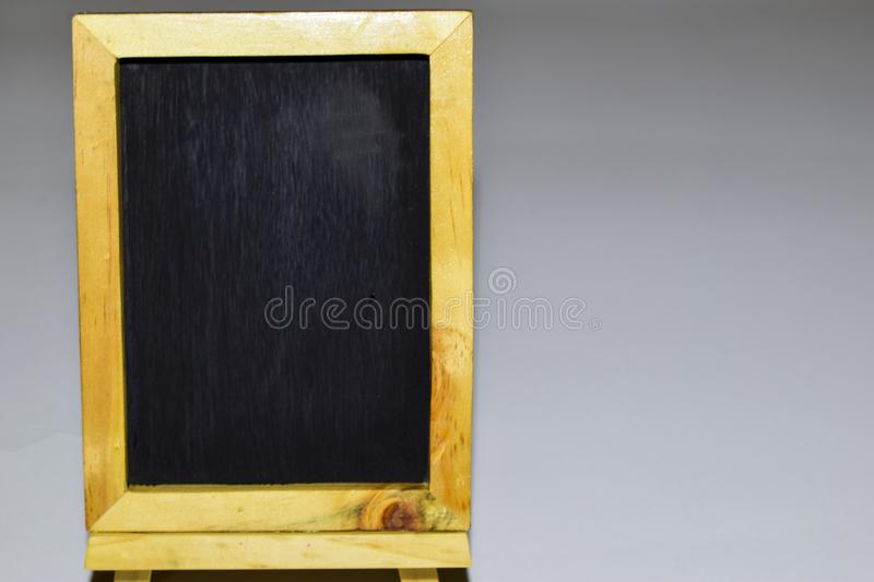 Vintage rectangular chalkboard with colorful chalk isolated on white background royalty free stock image