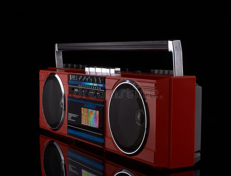 Vintage red boom box on black background. With reflection royalty free stock photos