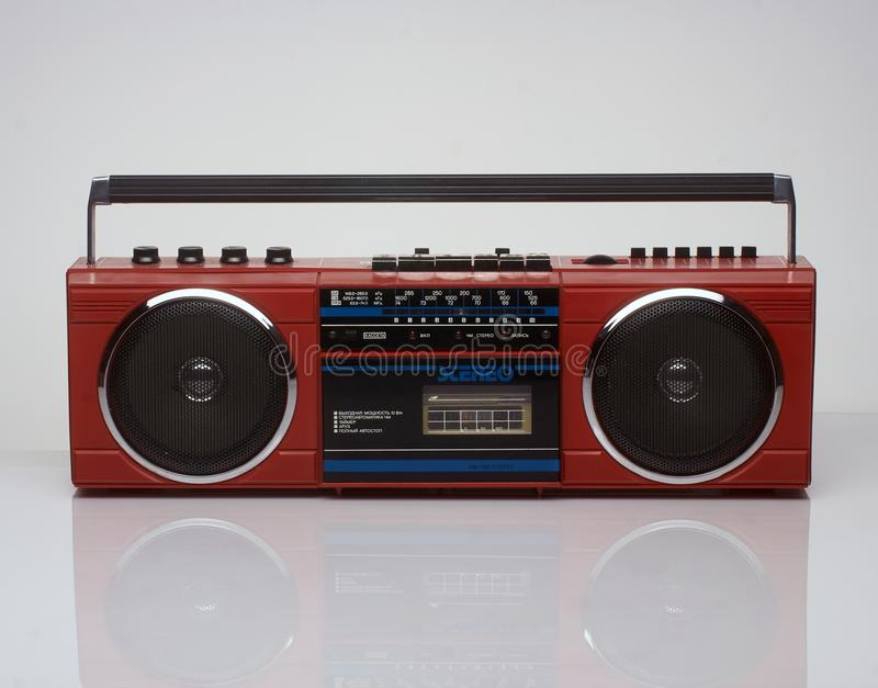 Vintage red boom box on white background. With reflection royalty free stock image