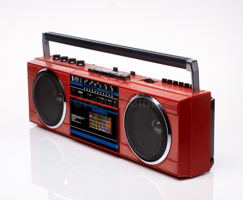 Vintage red boom box on white background. With reflection stock images