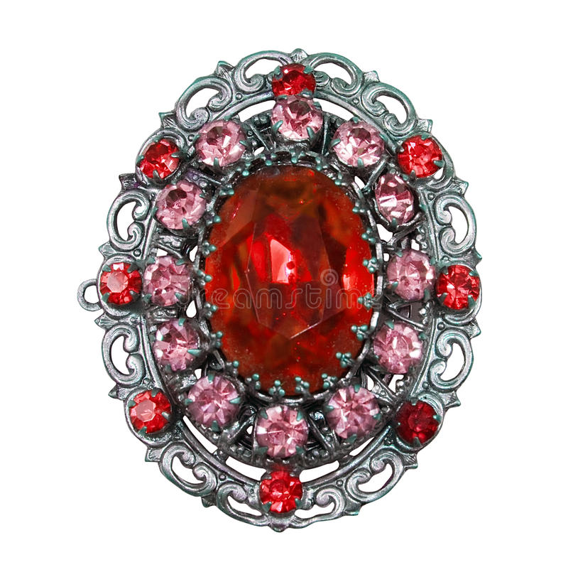 Vintage red brooch. Red brooch with rubis isolated on a white background royalty free stock photos