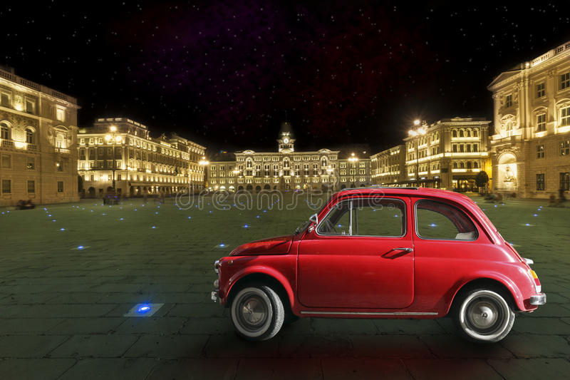 Vintage red car in the historic city of Trieste, Italy. Night royalty free stock photo