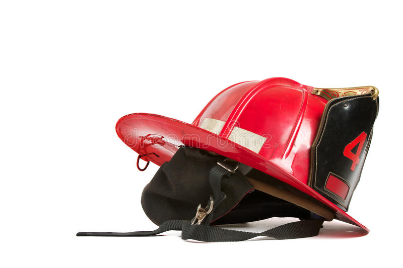 Vintage red fire fighters helmet stock photos