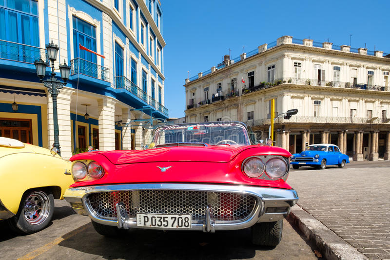Vintage red Ford Thunderbird convertible car parked in Old Havana. HAVANA,CUBA - MAY 29, 2017 : Vintage red Ford Thunderbird convertible car parked in Old Havana stock image